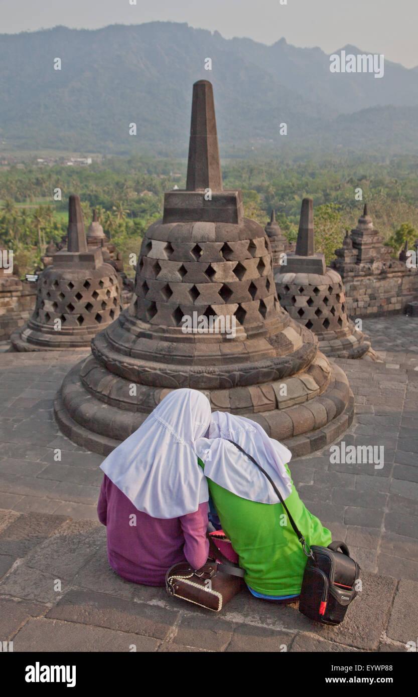 Local Muslim women visit the ancient Borobudur Buddhist Temple, UNESCO, near Yogyakarta, Indonesia, Southeast Asia, - Stock Image