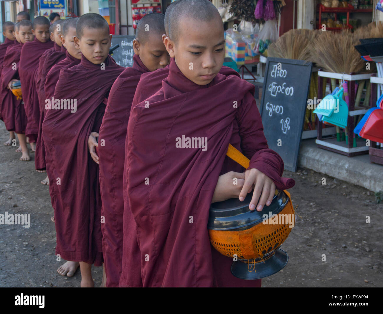Young monks receiving food gifts in Bagan, Myanmar (Burma), Asia - Stock Image