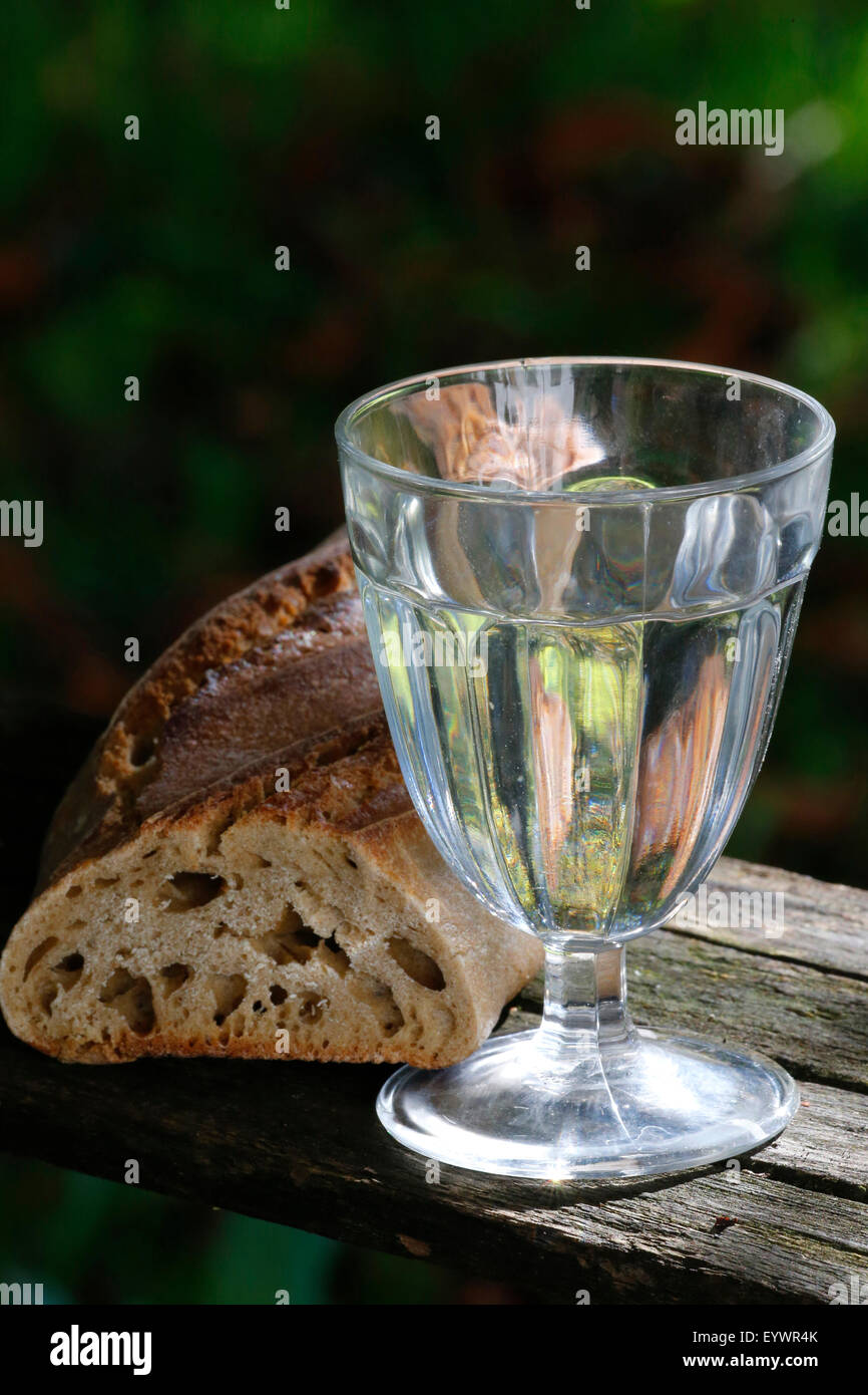 Bread and a glass of water during Lent, Haute-Savoie, France, Europe - Stock Image