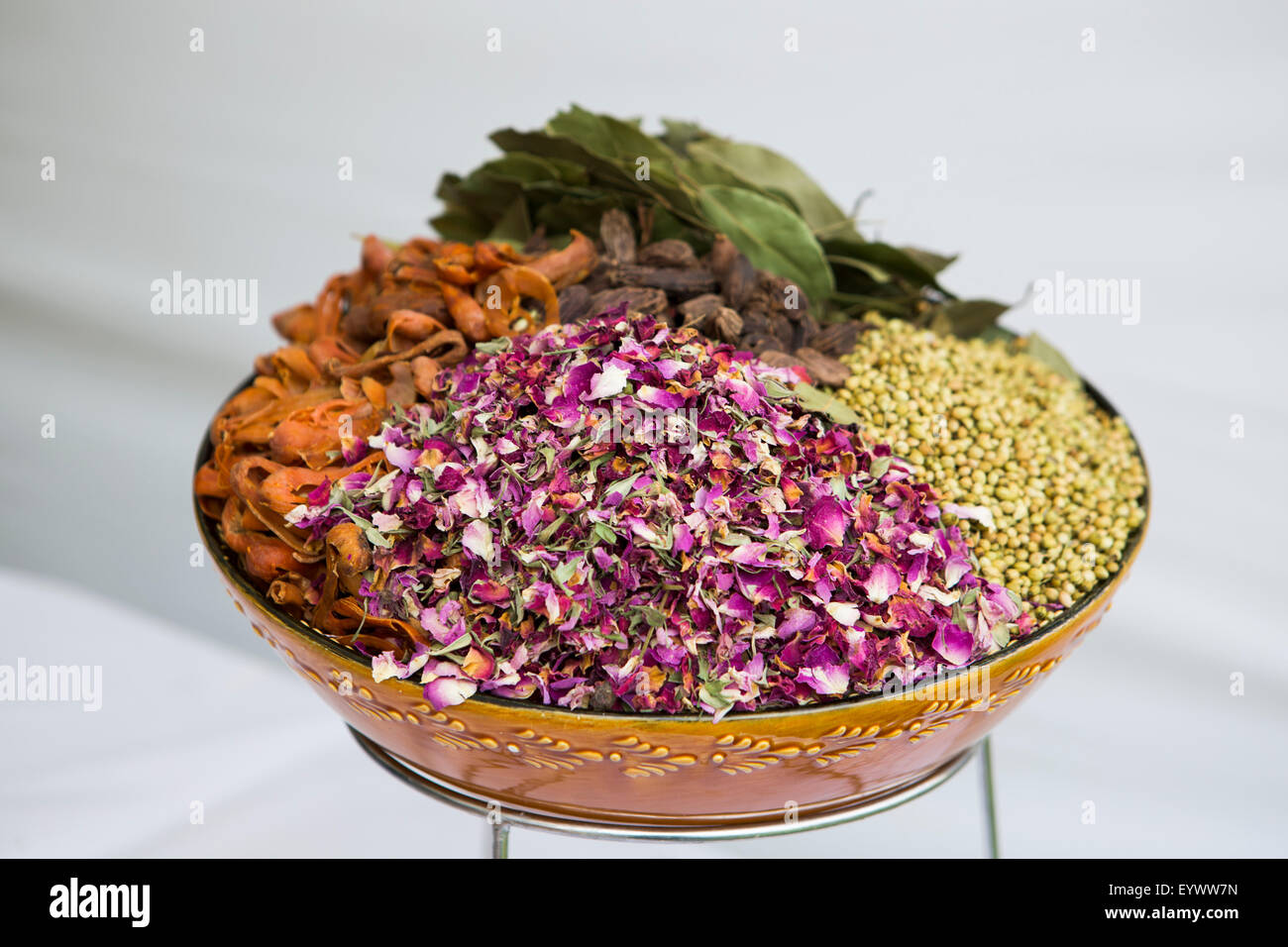 A bowl of spices and herbs used in Indian cookery including