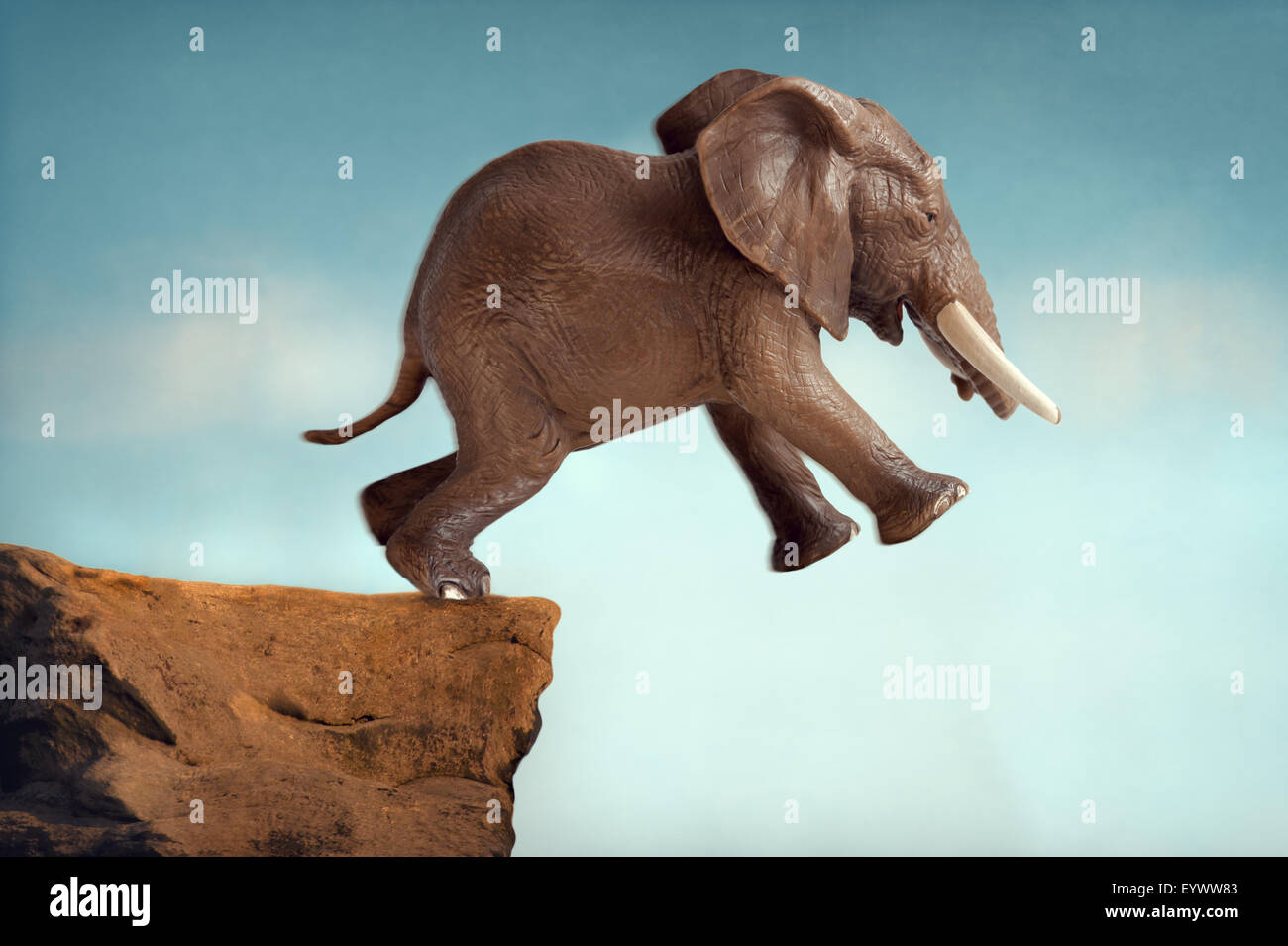 leap of faith concept elephant jumping into a void - Stock Image
