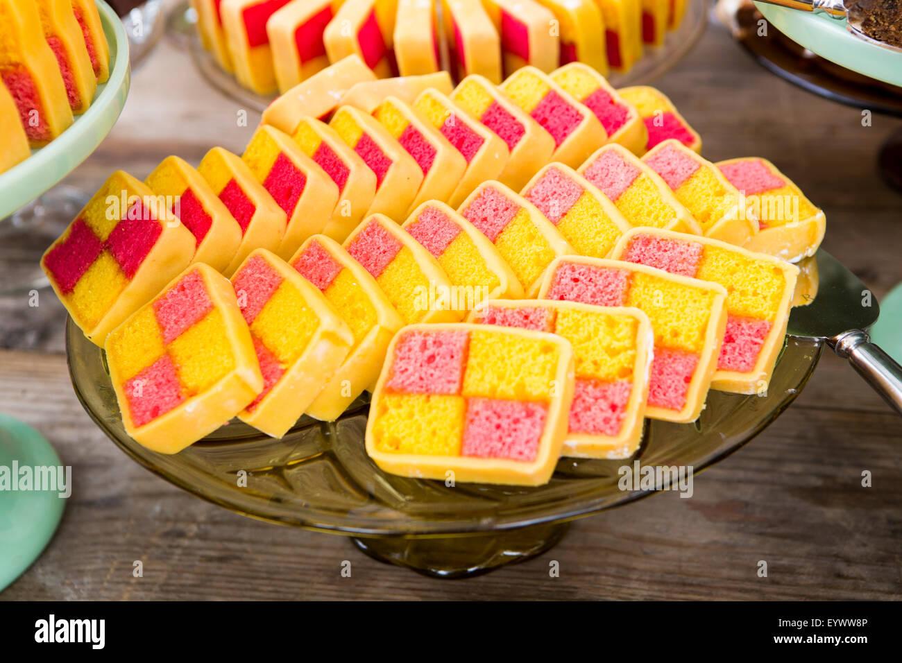 Battenburg cake sliced and served on vintage plate. - Stock Image
