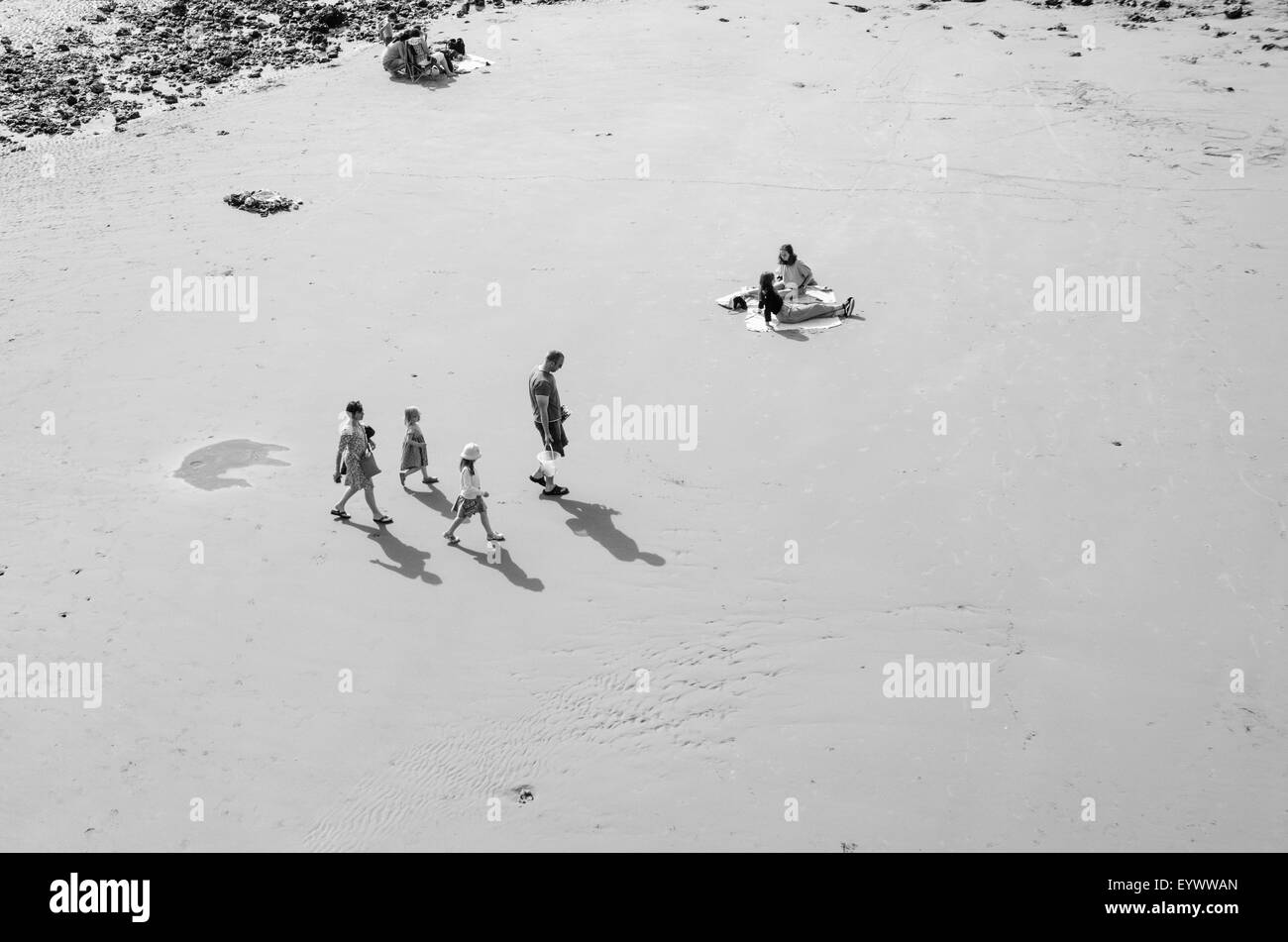 Family walking across Cromer beach Stock Photo