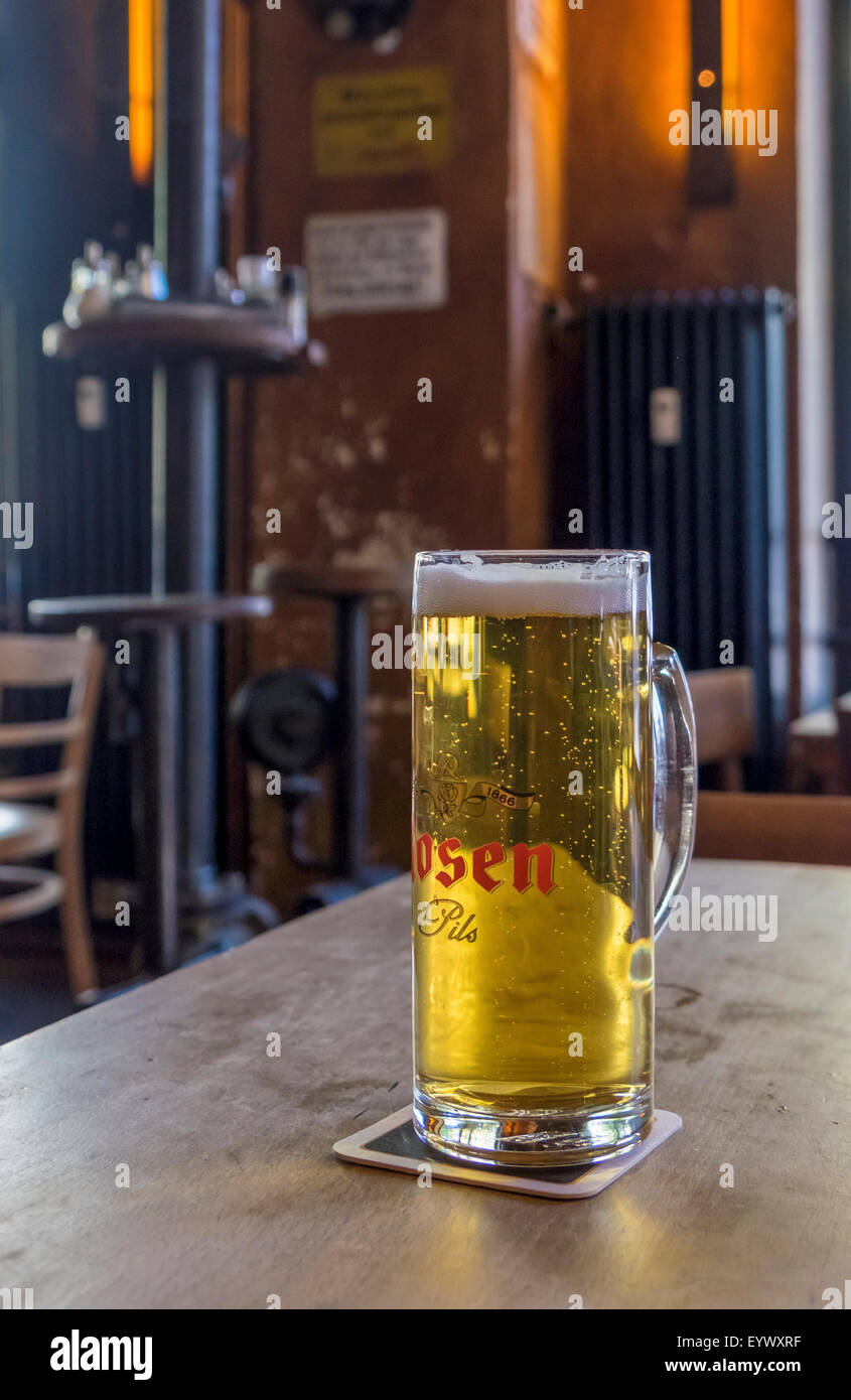 Schwarze Pumpe bar and cafe interior and glass of Rosen Pils, lager beer - Stock Image