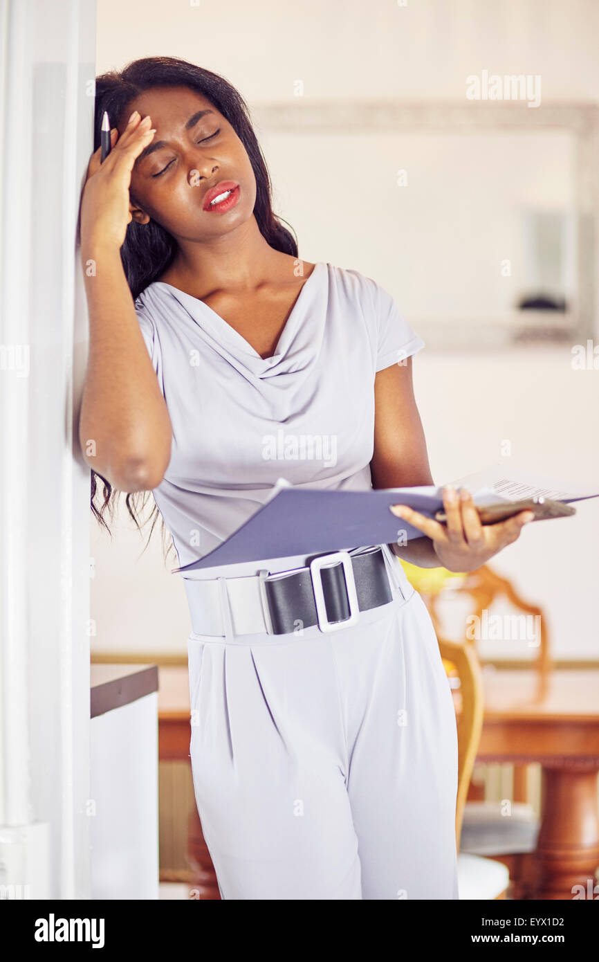Ethnic woman working out finances - Stock Image