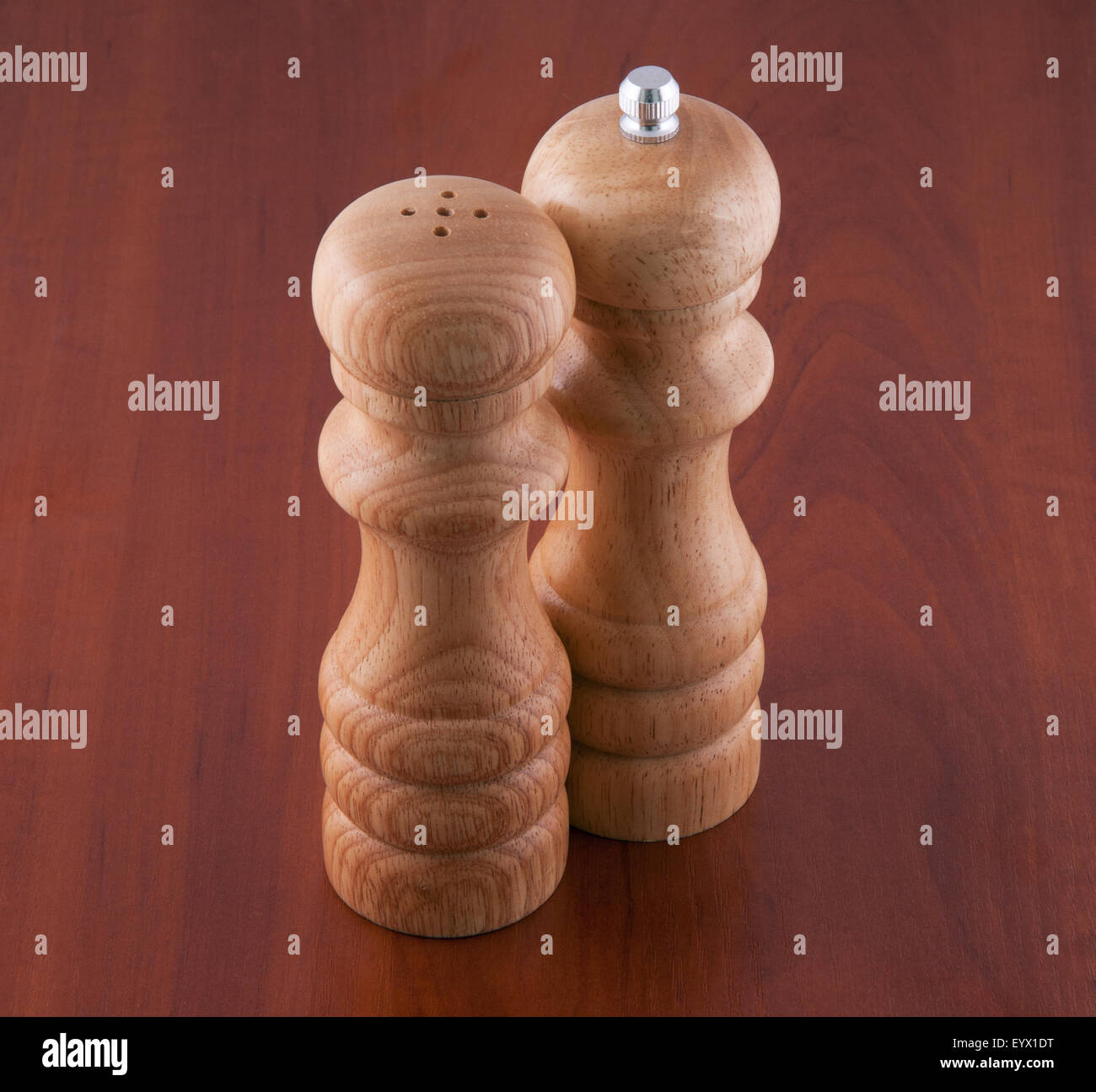 Salt-cellar and pepper-box on a table - Stock Image