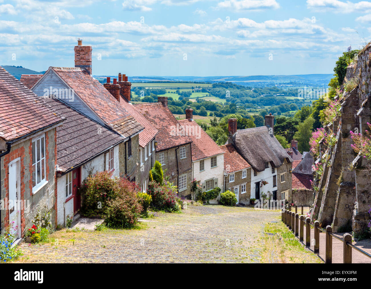 Gold Hill with the old abbey walls to the right, Shaftesbury, Dorset, England, UK - Stock Image