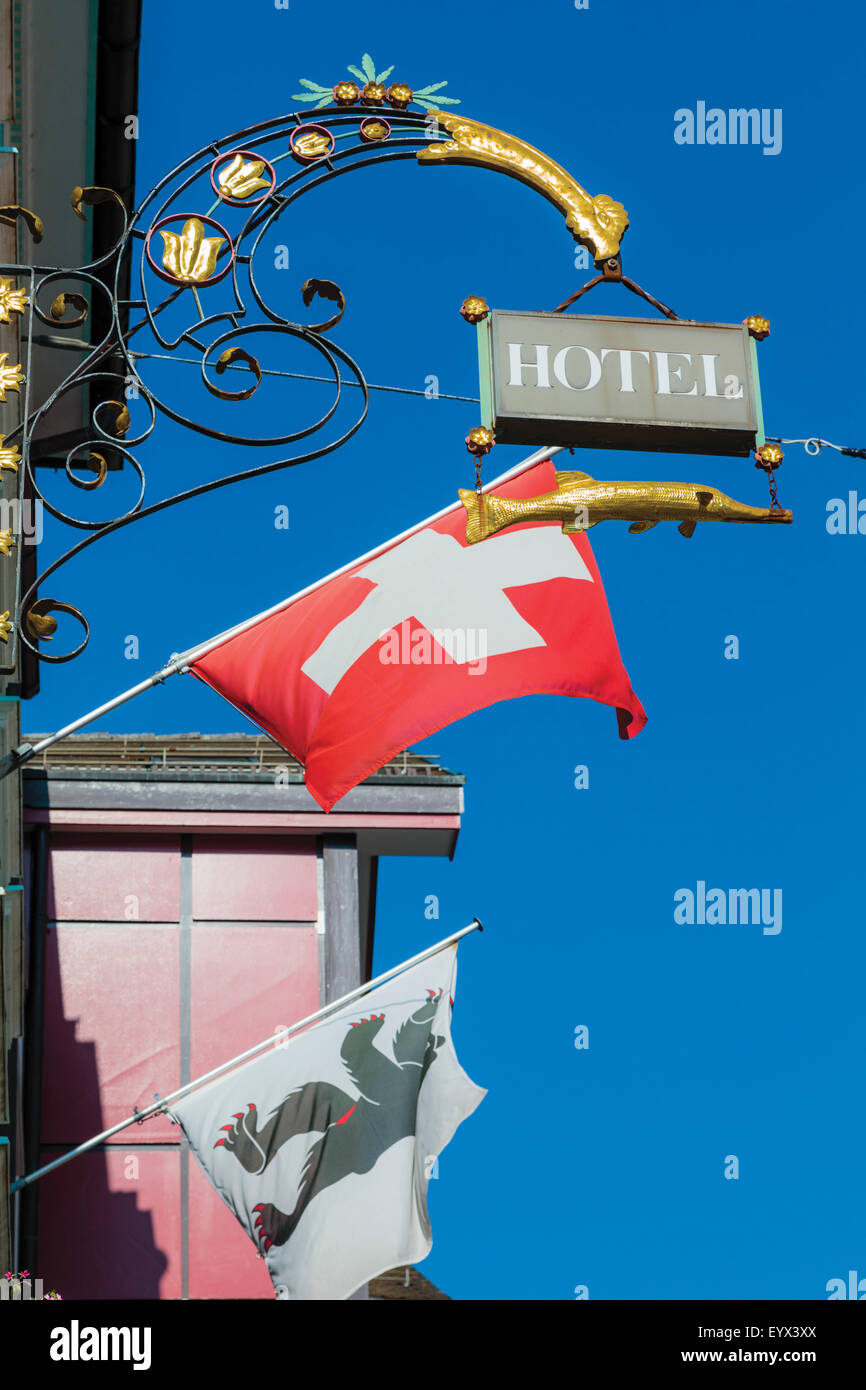 Appenzell, Appenzell Innerrhoden Canton, Switzerland.  Sign outside hotel.  Swiss flag.  The bear flag is the flag - Stock Image
