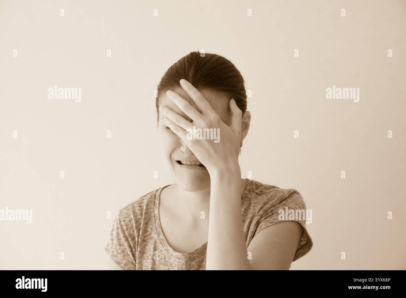Crying depressed sad abuse young woman, dramatic portrait - Stock Image