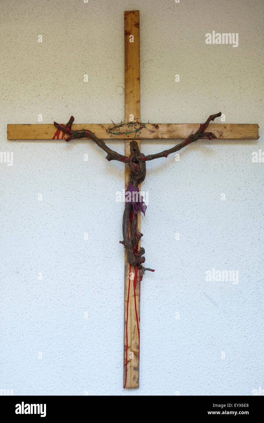 Croatia. A church crucifix with figure of Christ made from a twisted vine root - Stock Image