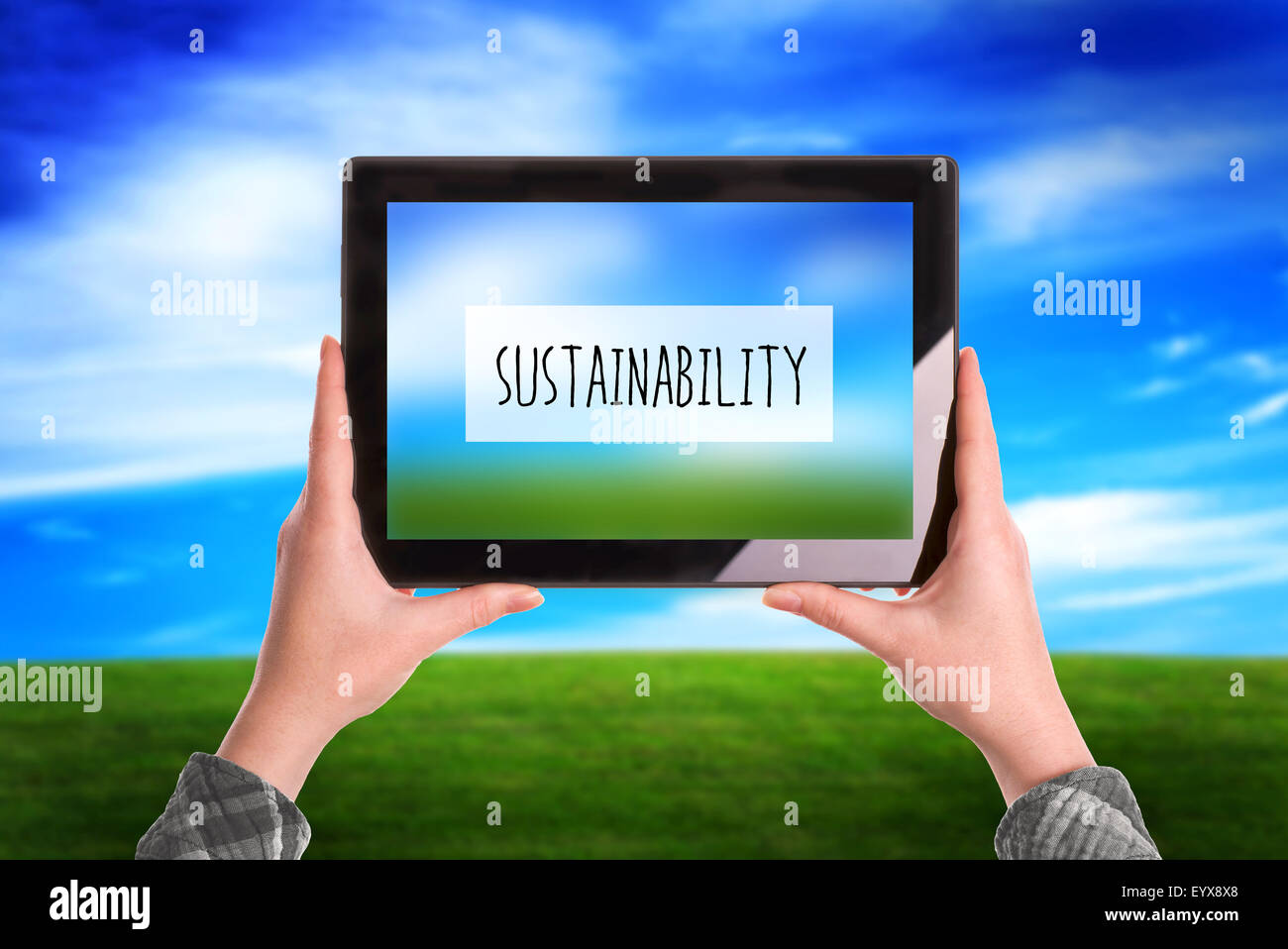 Sustainability Concept, Woman with Digital Tablet Computer Taking Picture of Natural Grassland Landscape - Stock Image