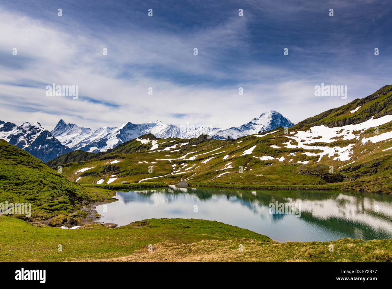 Bachsee with mountain backdrop above Grindelwald - Stock Image