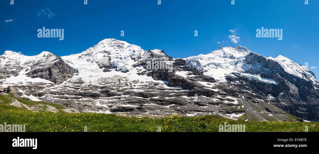 Panoramic view of Monch and Jungfrau from the Eiger walk just above Kleine Scheidegg - Stock Image