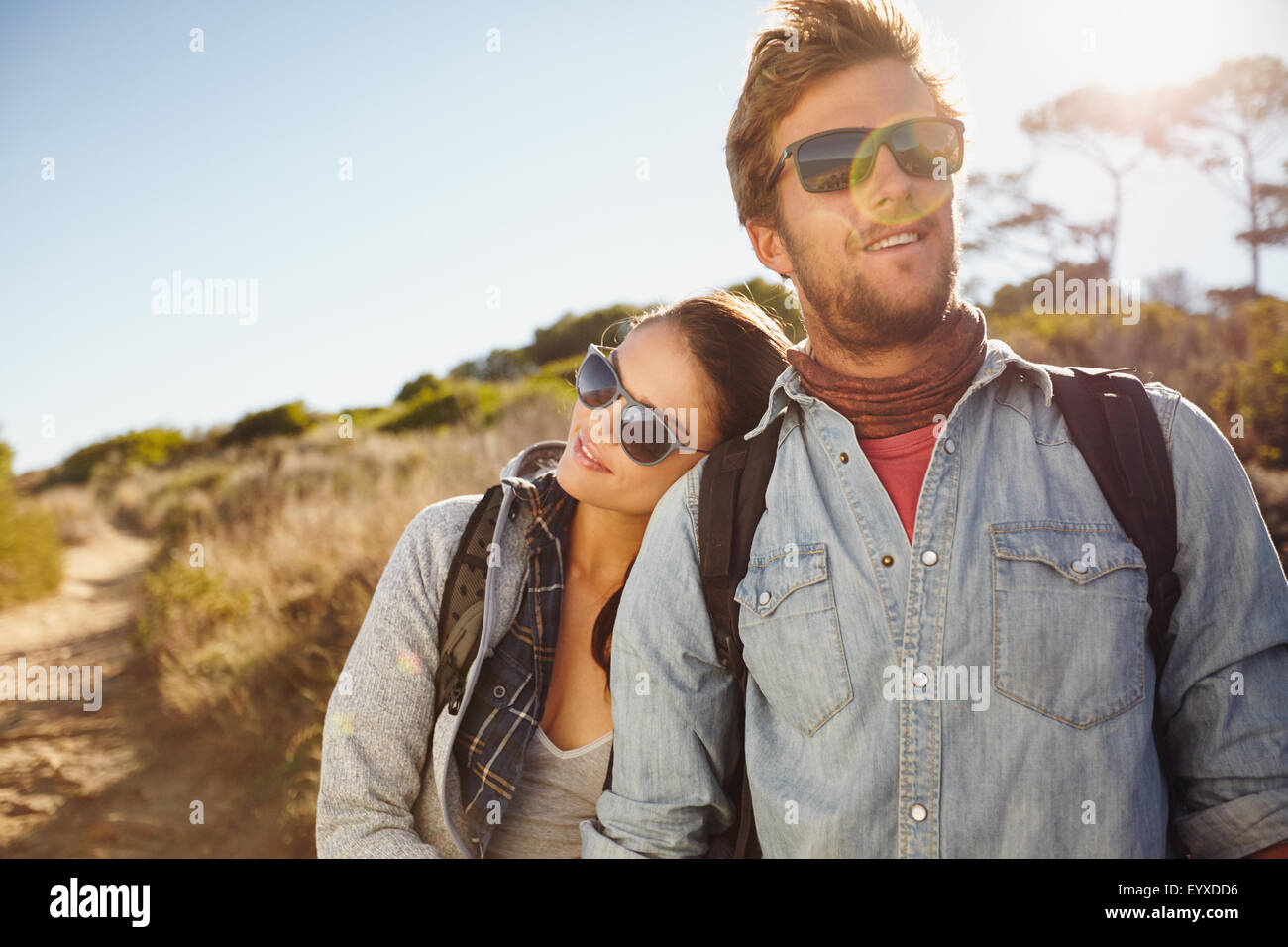 Portrait of young couple in love on hike. Young beautiful couple hikers in their twenties on hike. Young caucasian - Stock Image