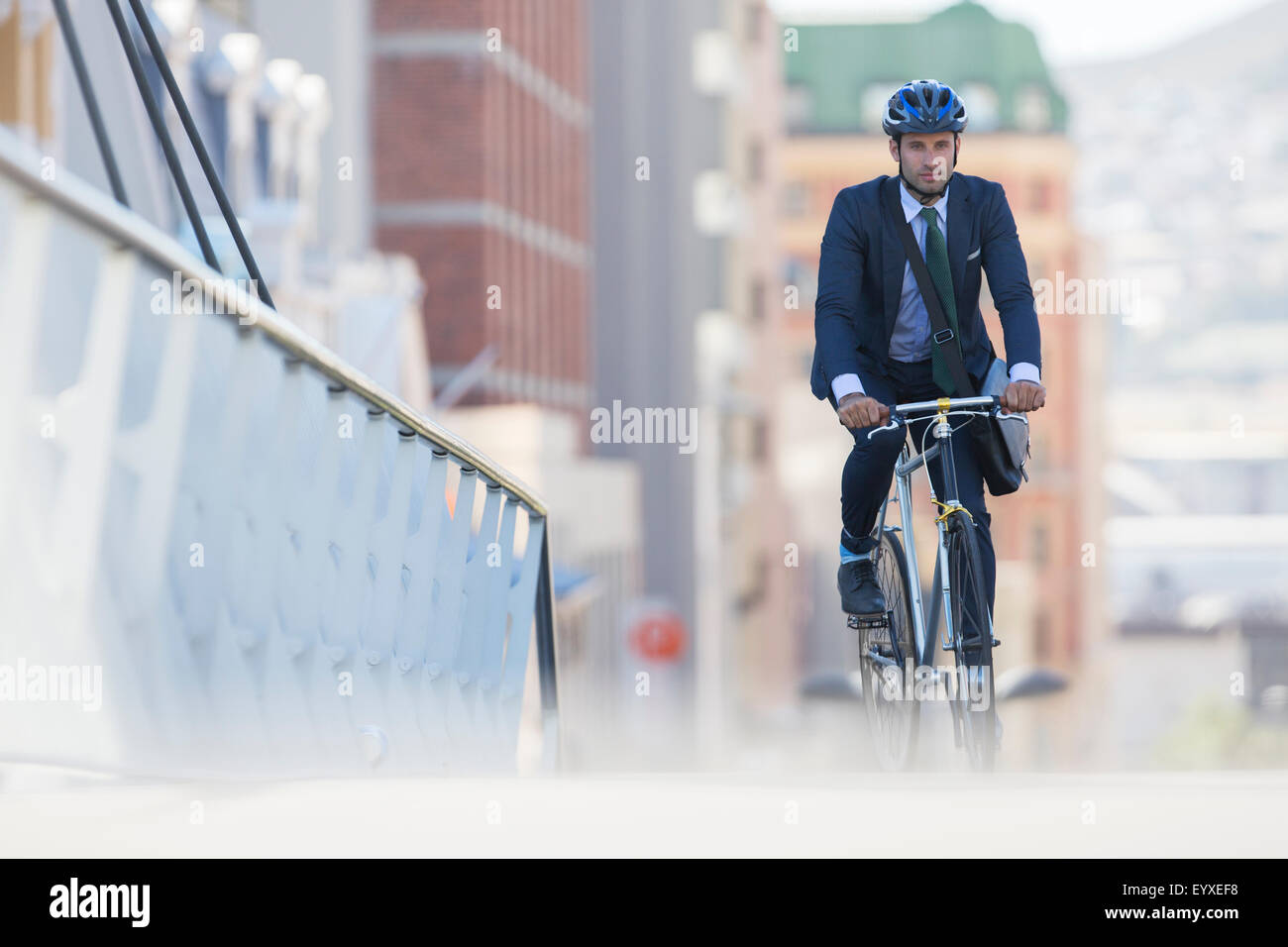 Businessman In Suit And Helmet Riding Bicycle In City Stock Photo Alamy