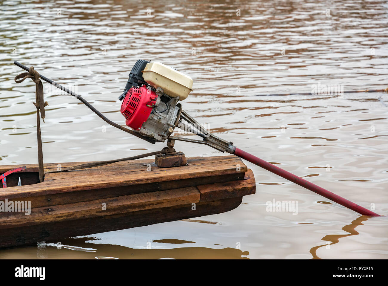 Motor on a wooden canoe near Iquitos, Peru - Stock Image