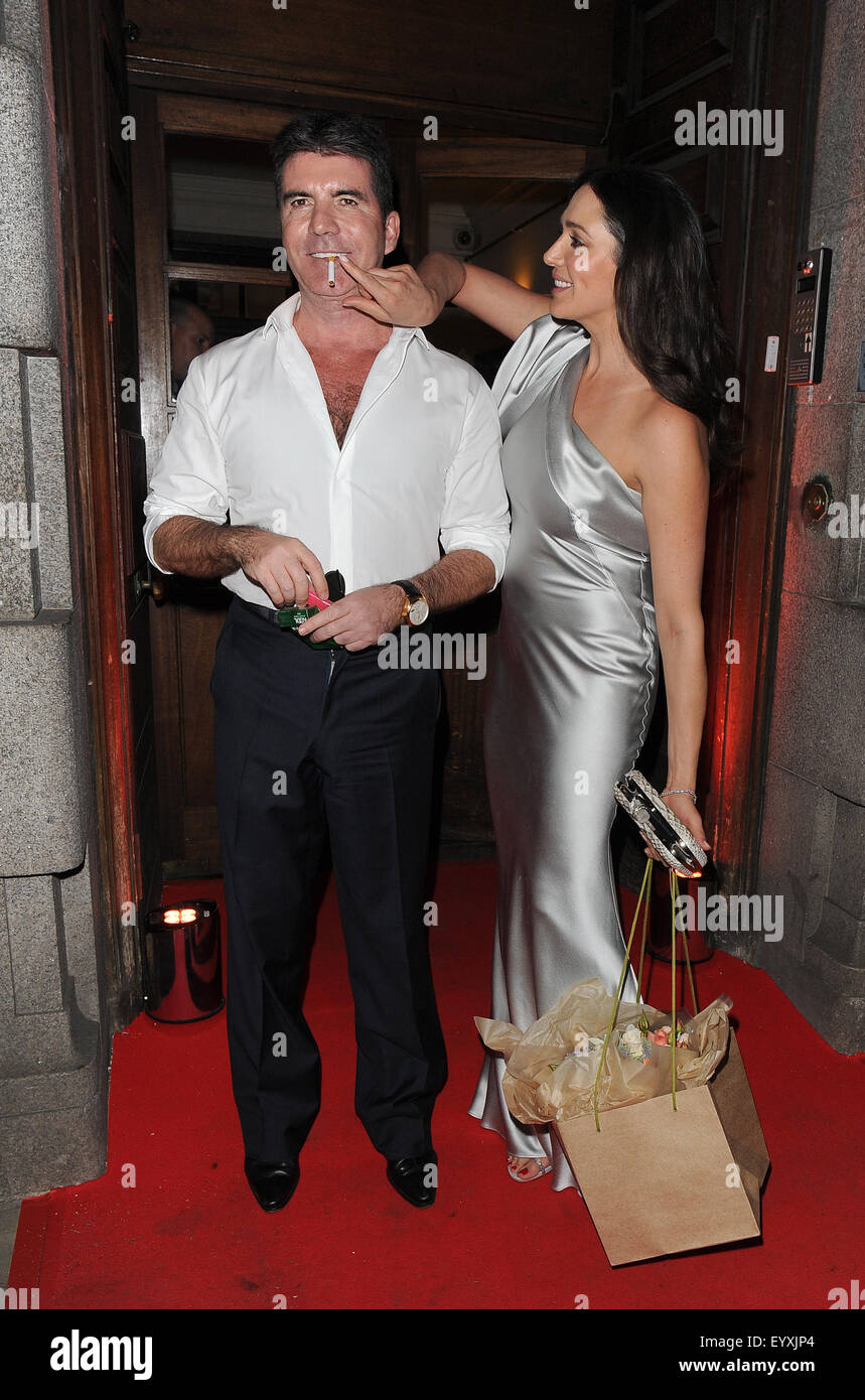 Simon Cowell And Wife Lauren Silverman Join Amanda Holden At A Stock Photo Alamy