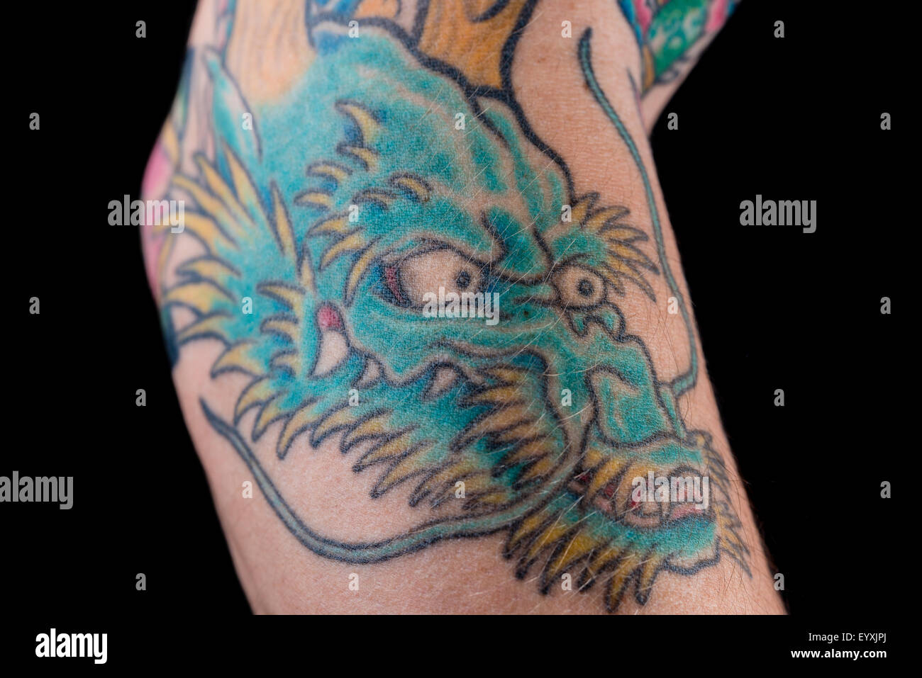 A Detailed Shot Of A Blue Green Dragon Tattoo In Japanese Style On