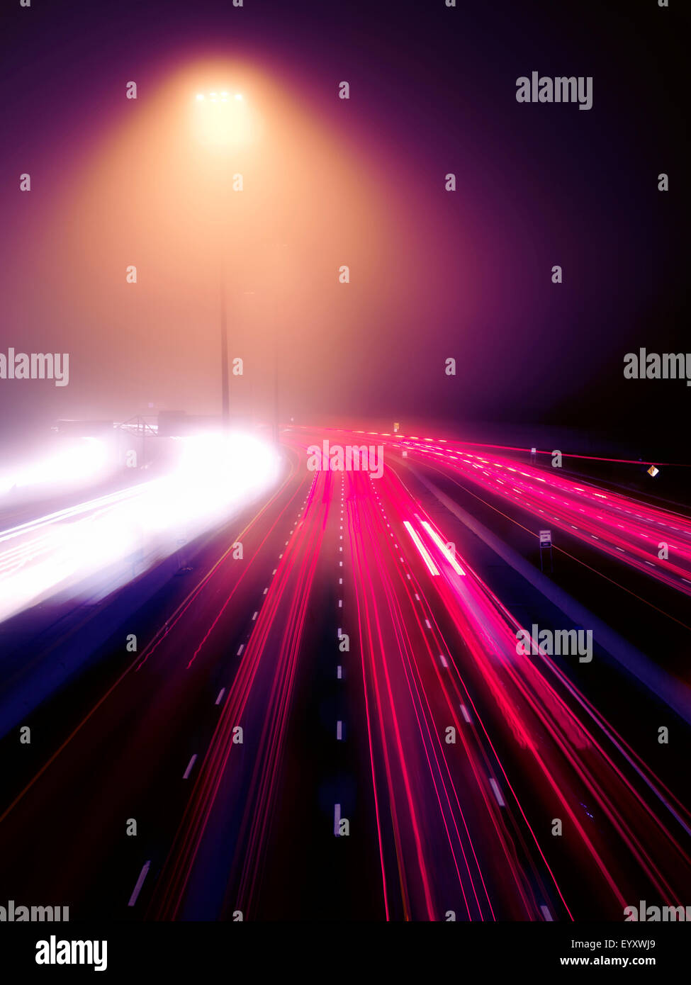Colorful highway traffic on a foggy night, Highway 401, Toronto, Ontario, Canada. - Stock Image