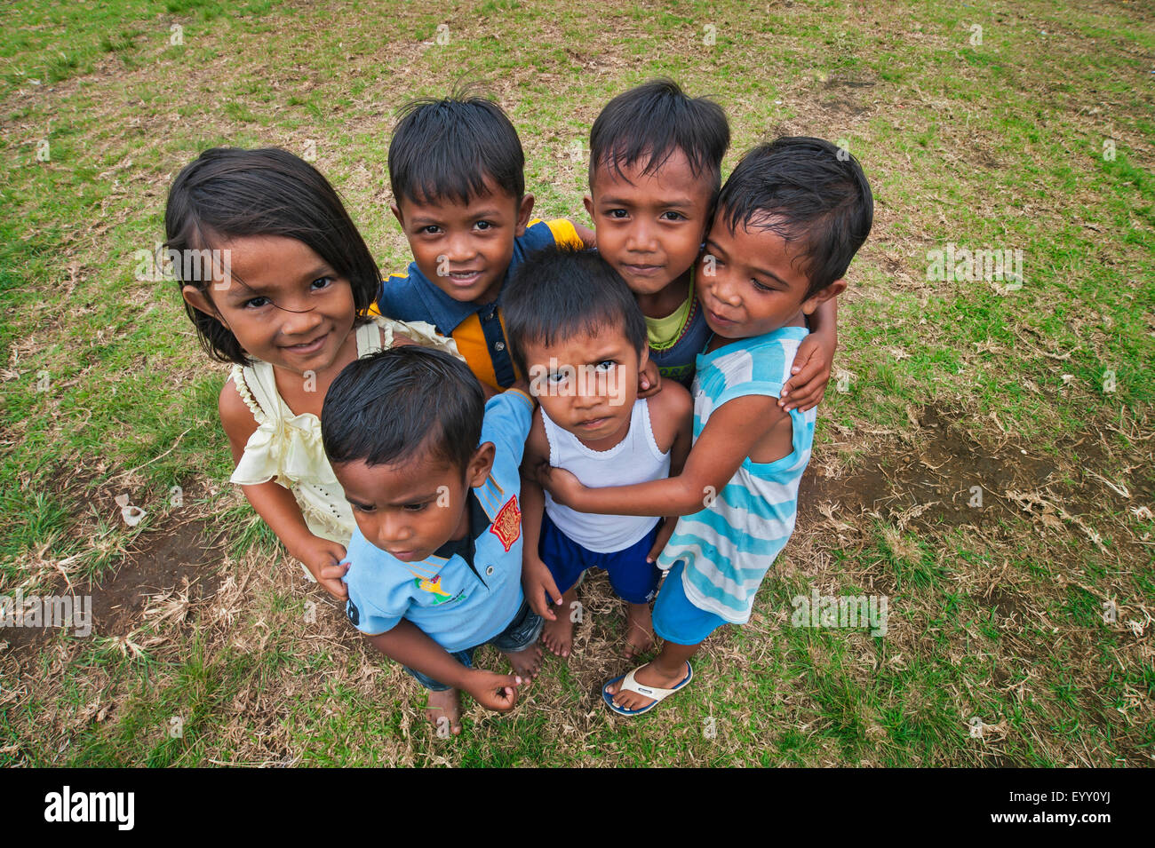 Small children hugging each other, Lonthor, Banda, Moluccas, Indonesia Stock Photo