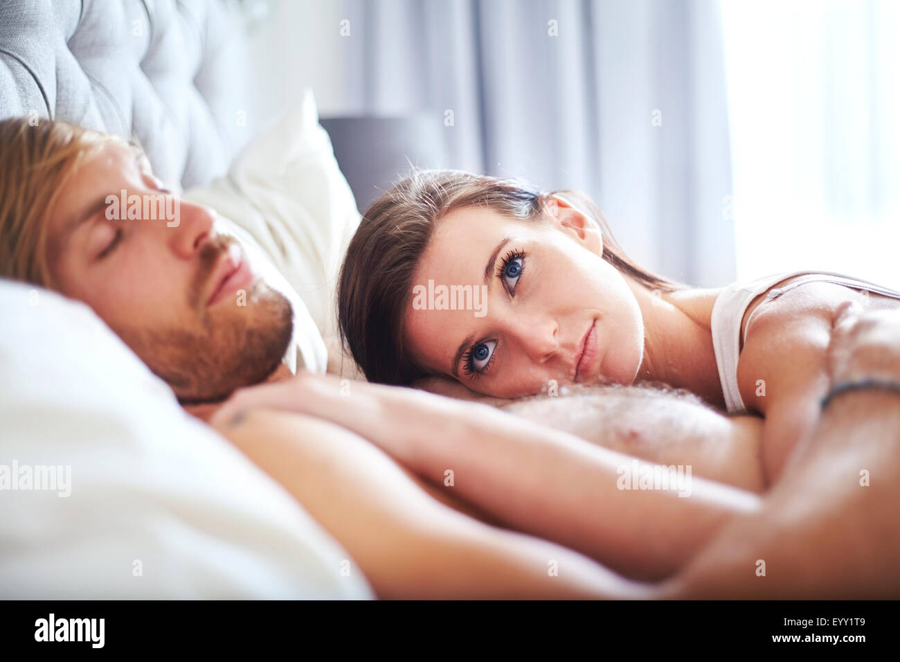 Man and girl in bed