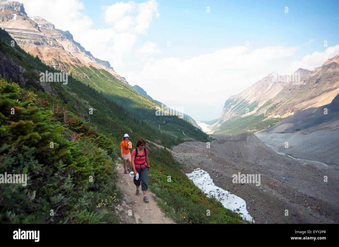 Caucasian mother and daughter hiking on Six Glaciers Trail, Banff, Alberta, Canada - Stock Image