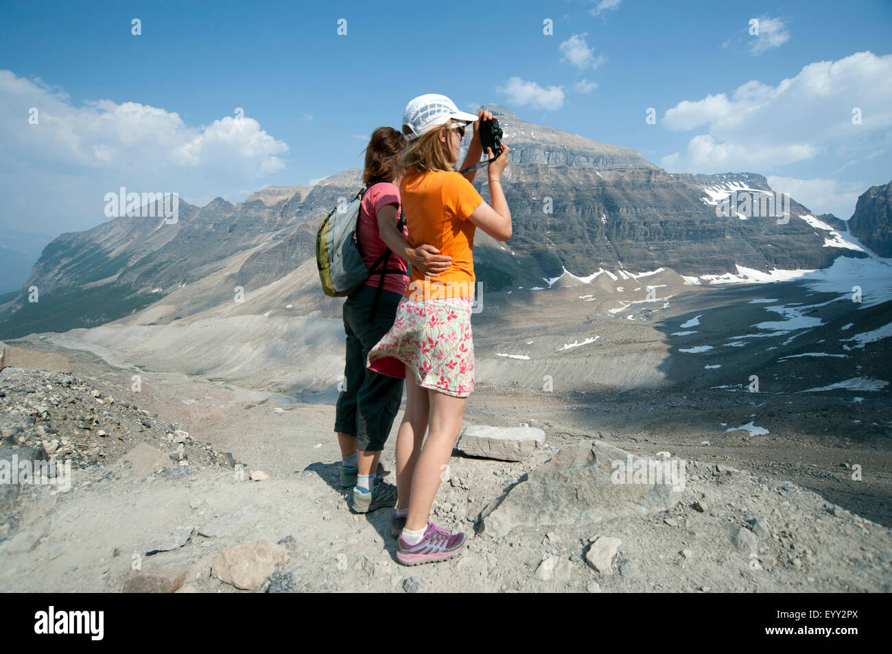 Caucasian mother and daughter photographing scenic view of Six Glaciers Trail, Banff, Alberta, Canada Stock Photo