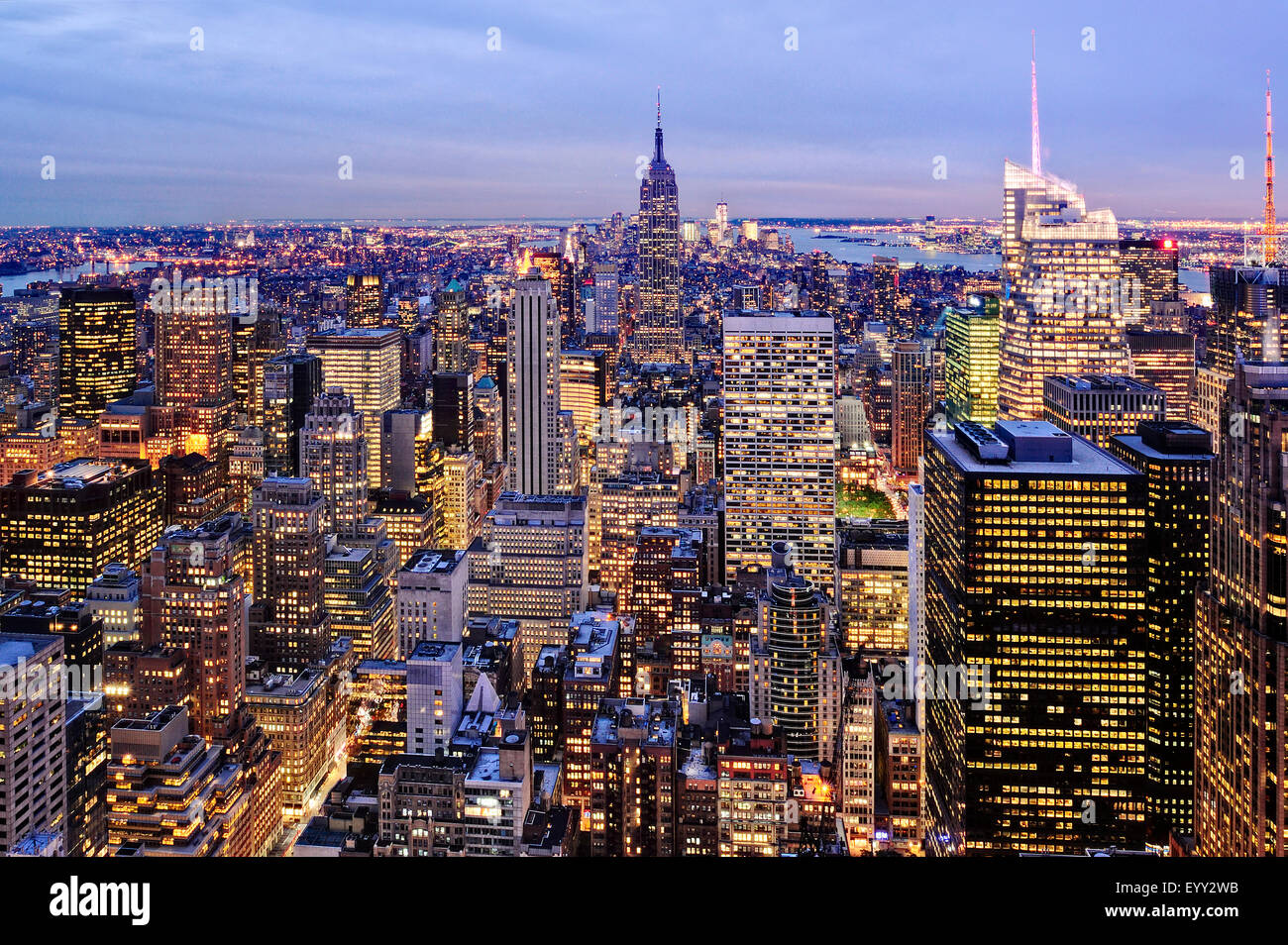 Aerial view of highrise buildings in cityscape at twilight - Stock Image