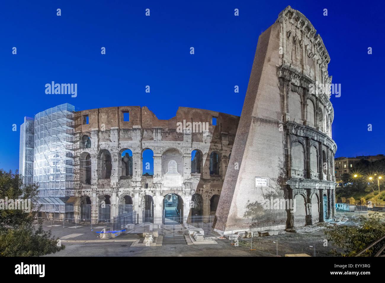 Coliseum ruins illuminated at night, Rome, Italy - Stock Image