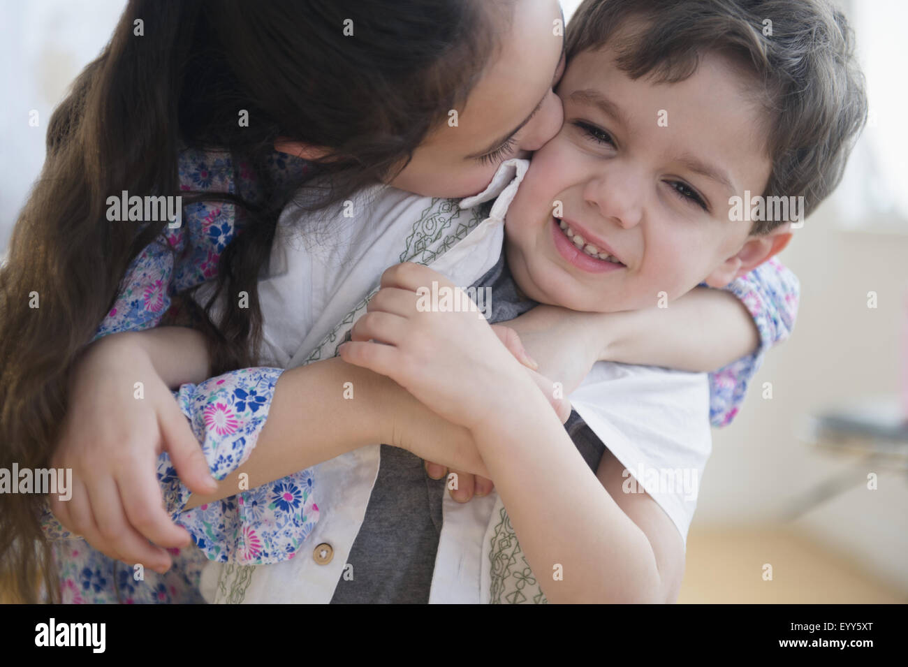 Close up of Caucasian girl kissing brother Stock Photo