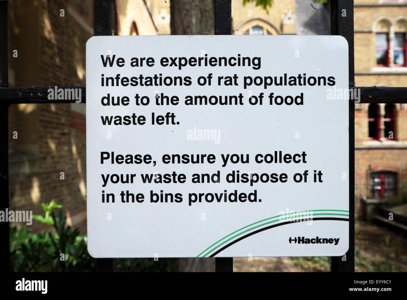Pest sign on a Hackney railing warning of increase of rat populations due to food waste in Hackney, East London - Stock Image