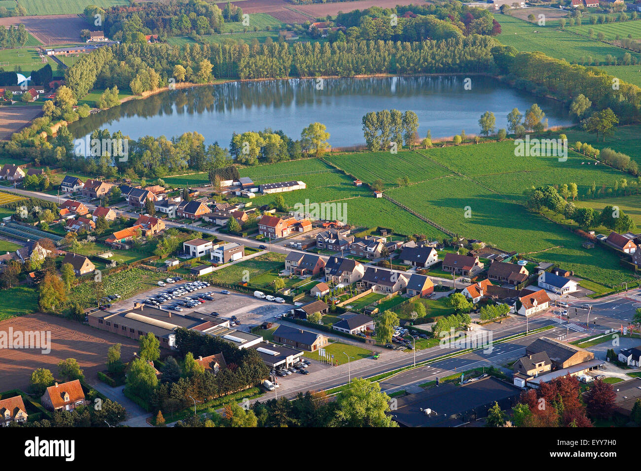lake, urbanisation at the border of agricultural area from the air, Belgium - Stock Image