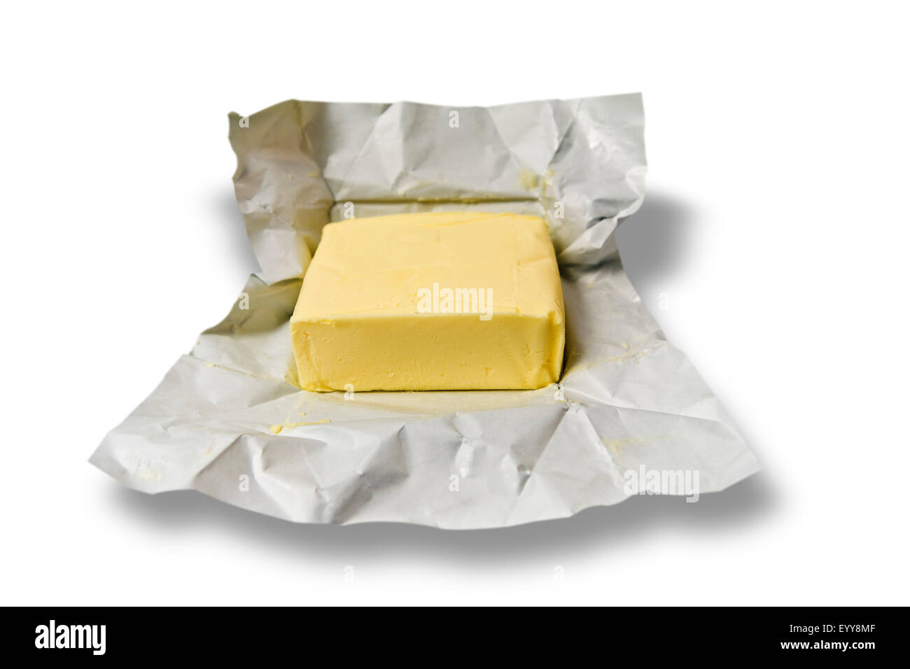 opened package with butter - Stock Image