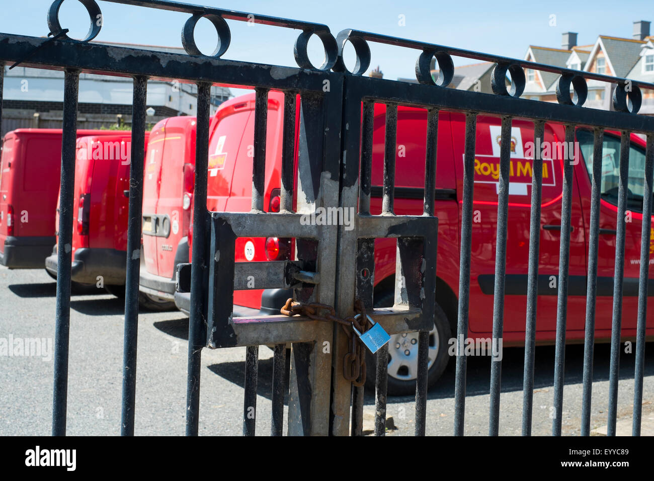 Royal Mail delivery vans locked in delivery office car park at Bude, Cornwall, England, UK - Stock Image