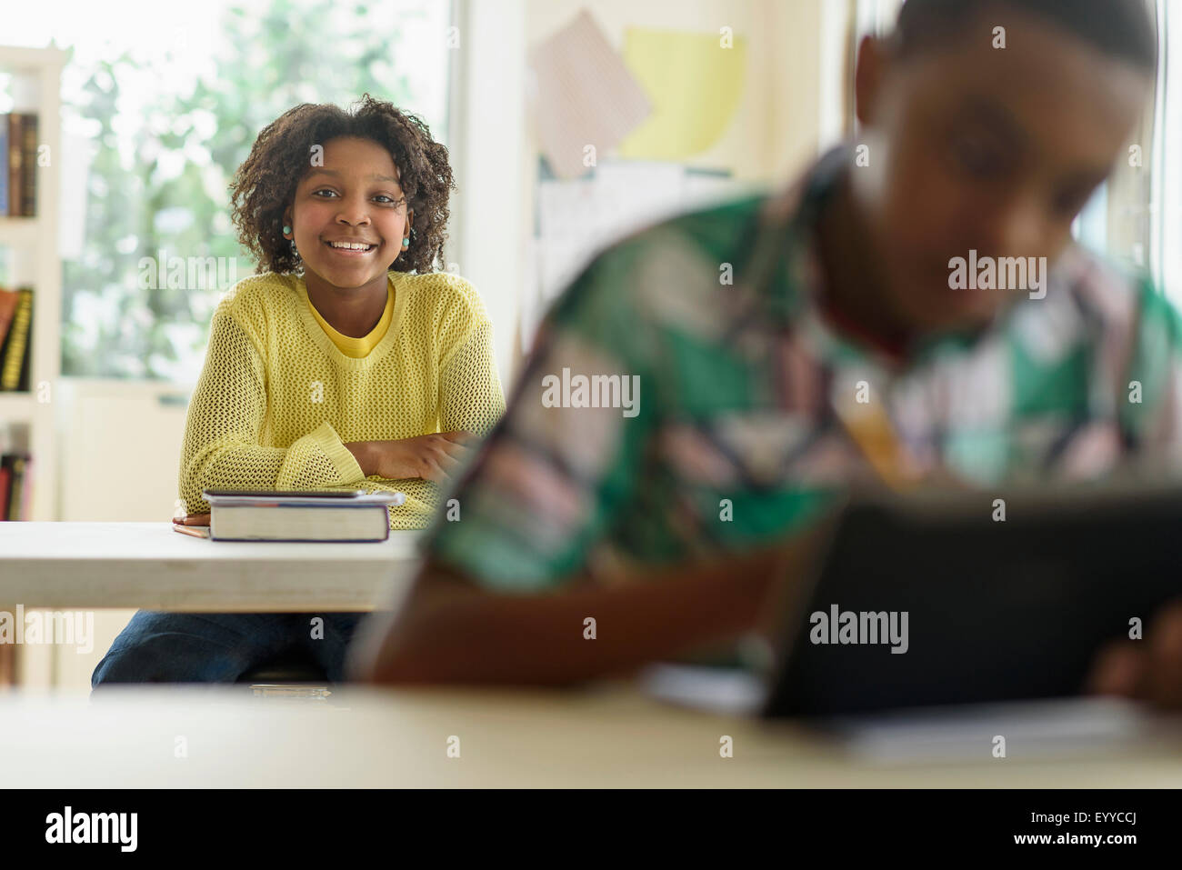 Black student smiling in classroom Stock Photo