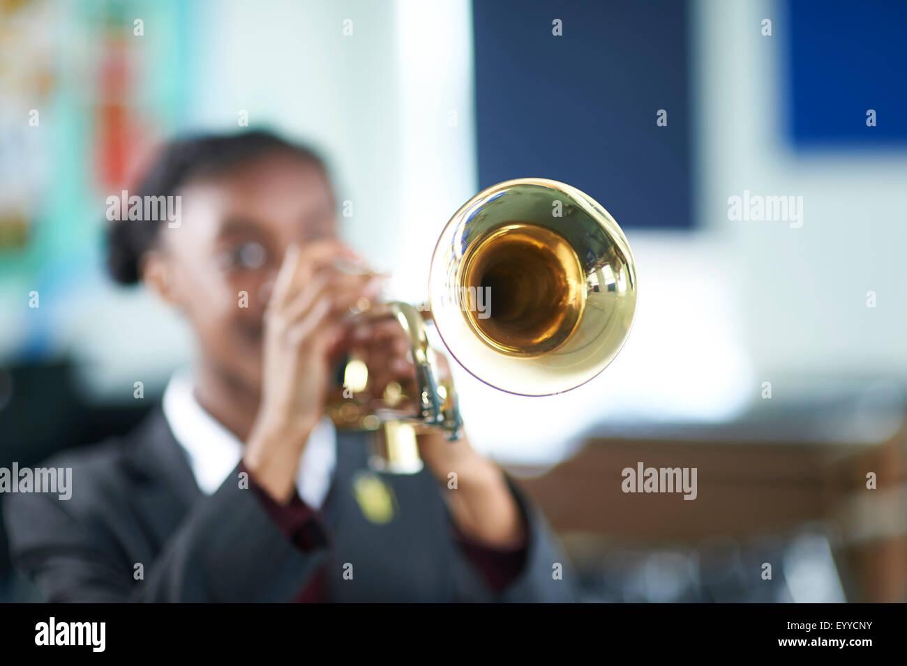 trumpet playing - Stock Image