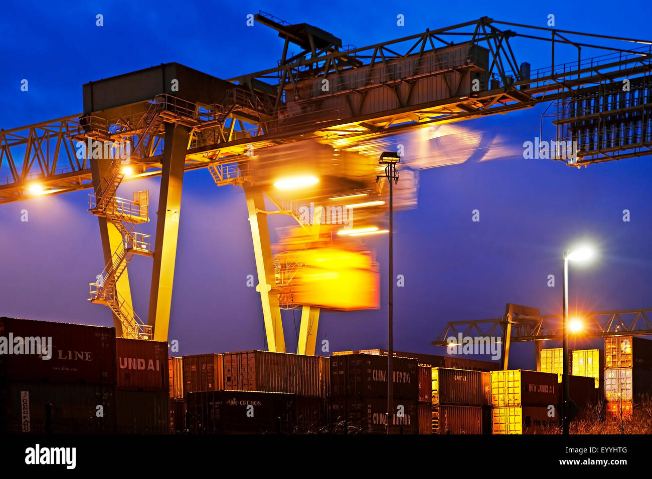 Dortmund Port with container gantry crane in the evening, Germany, North Rhine-Westphalia, Ruhr Area, Dortmund - Stock Image