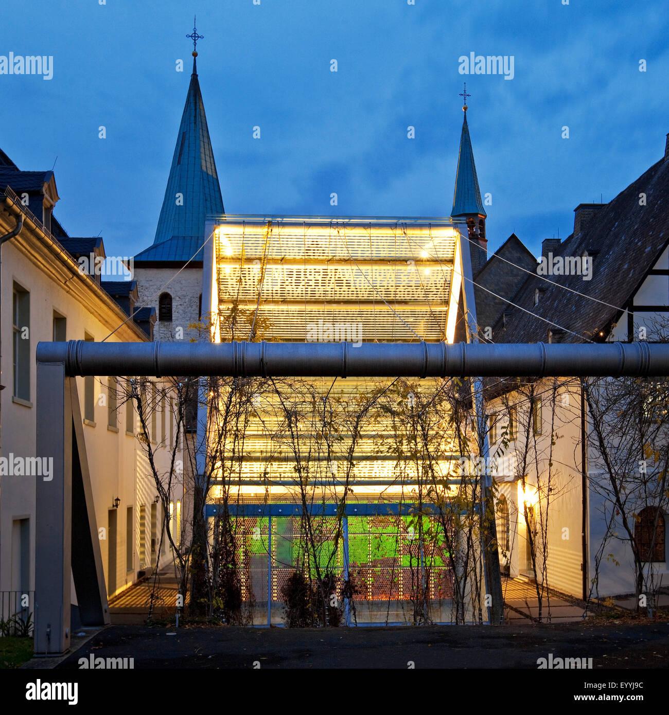 Wedinghausen monastery with light house 'Lichthaus' in the evening, Germany, North Rhine-Westphalia, Sauerland, Stock Photo