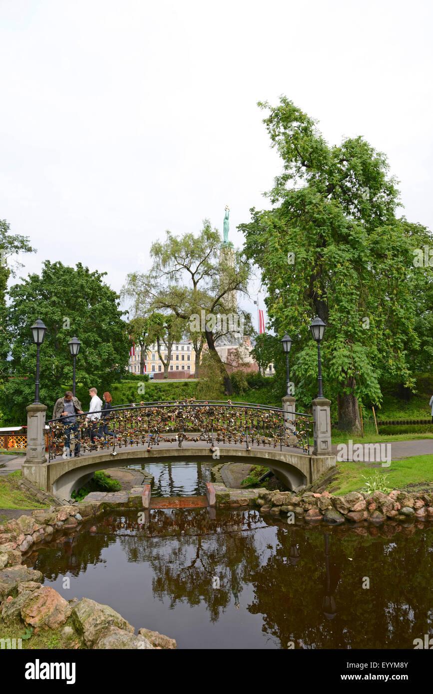 love locks at a pictorial bridge , Latvia, Riga - Stock Image