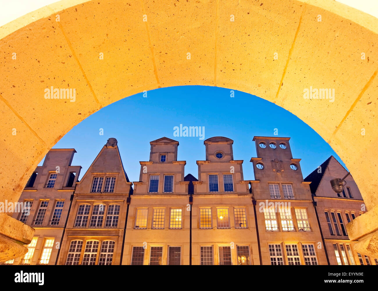 view through arcade to row of houses at historic principal marketplace, Germany, North Rhine-Westphalia, Munster - Stock Image