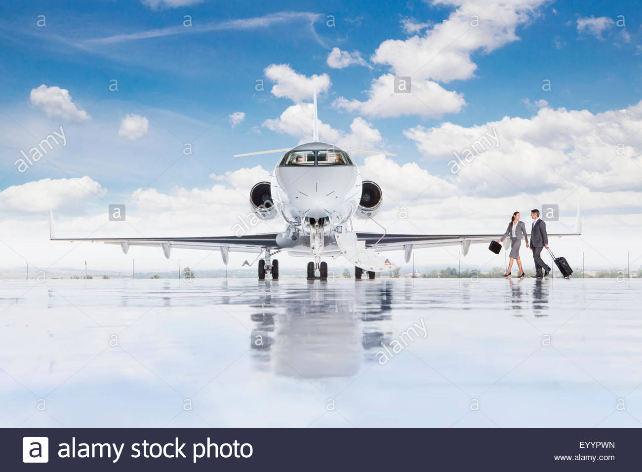 Businesswoman and Businessmen boarding private jet - Stock Image