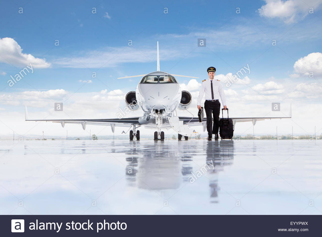 Pilot walking away from private jet - Stock Image