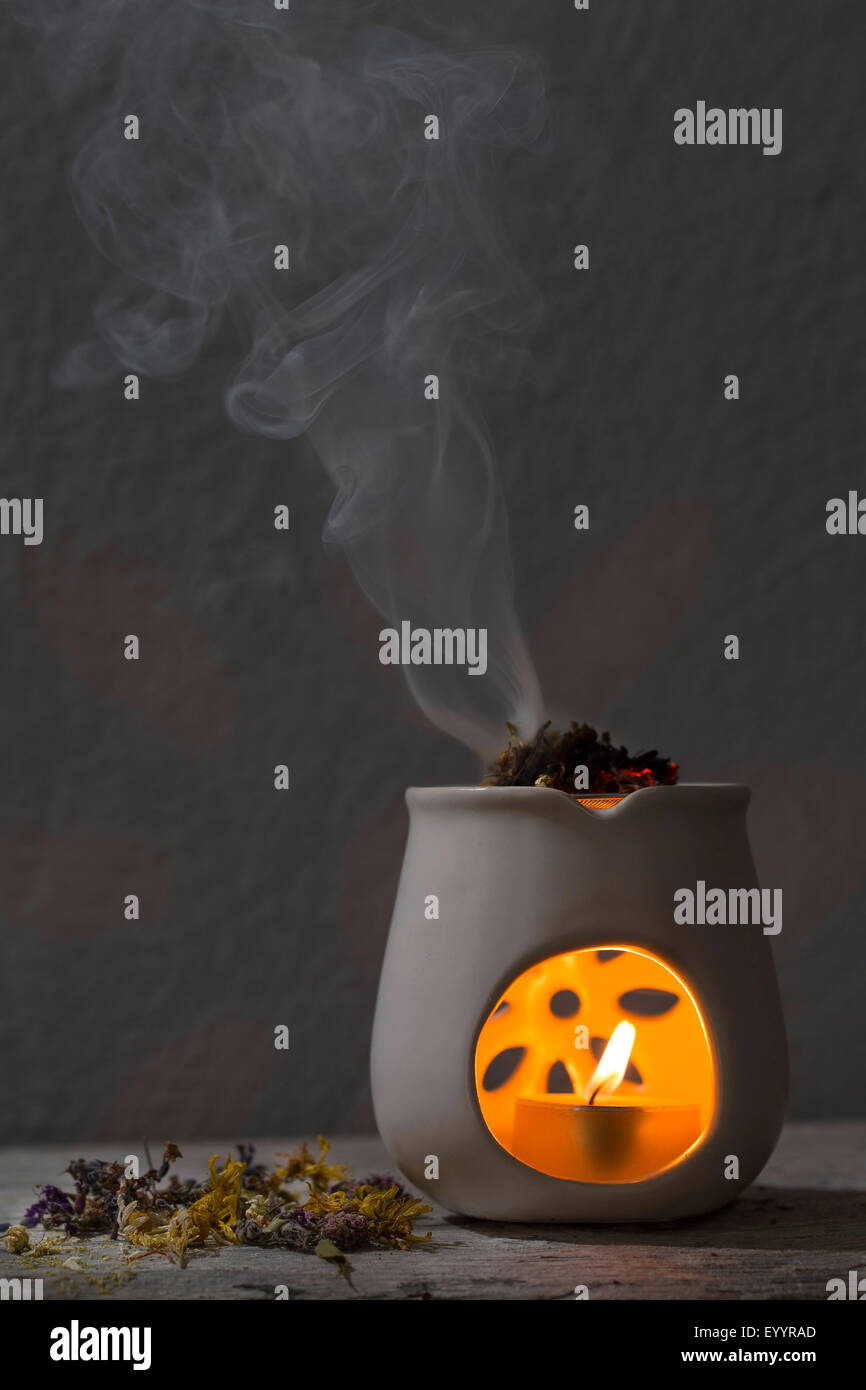 burning incense with herbs, aroma lamp Stock Photo