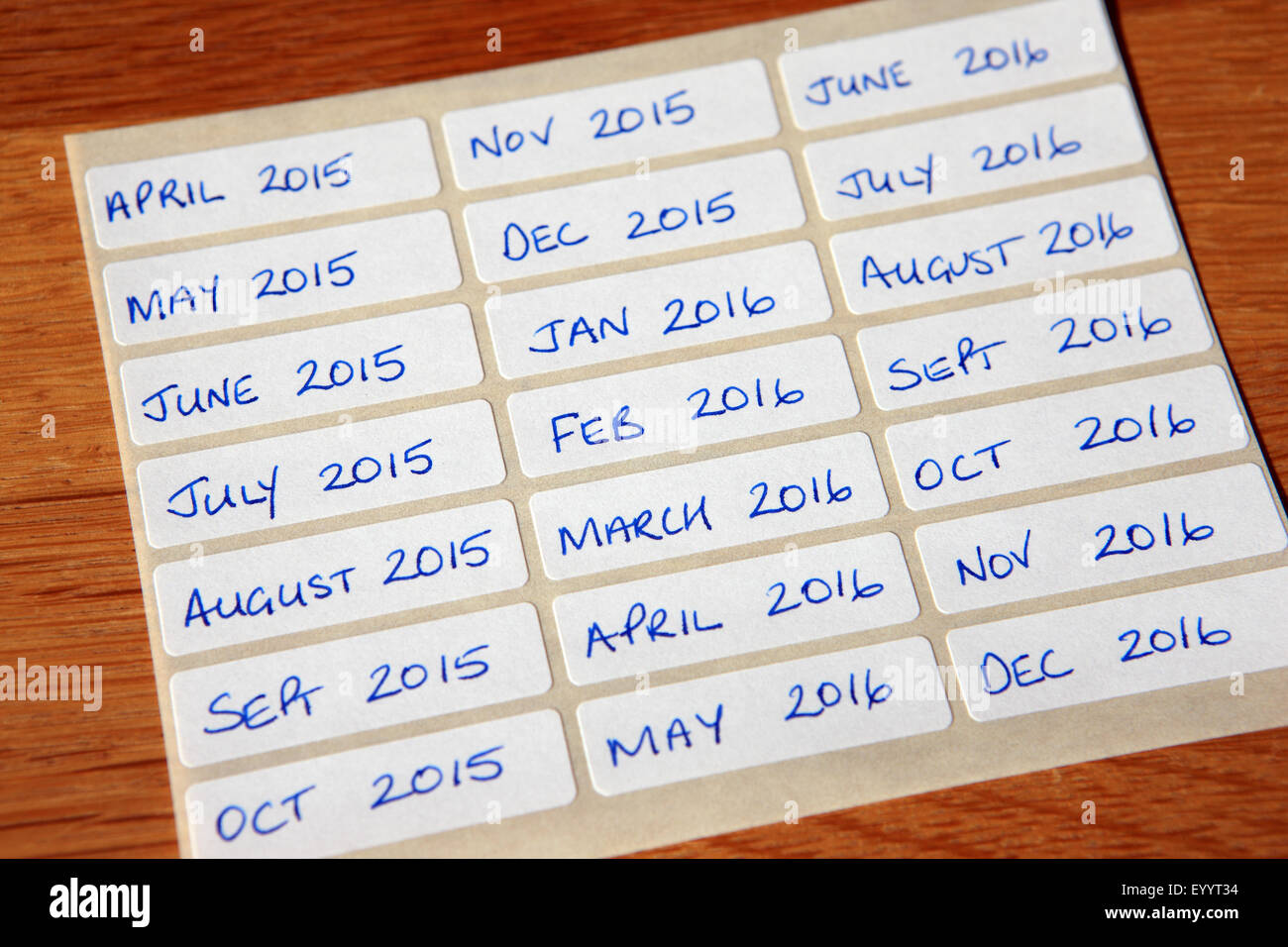 Hand written sticky labels April 2015 - December 2016 - Stock Image