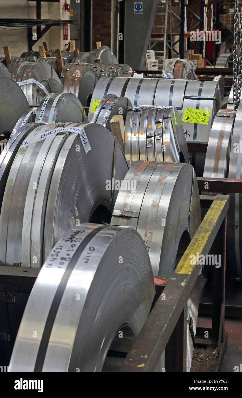 Rolls of steel plate of different sizes await use at a UK metal working factory Stock Photo