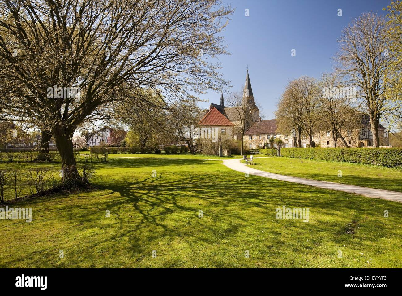 Cloister of the Order of Saint Benedict in Herzebrock with minster Saint Christina, Germany, North Rhine-Westphalia, - Stock Image