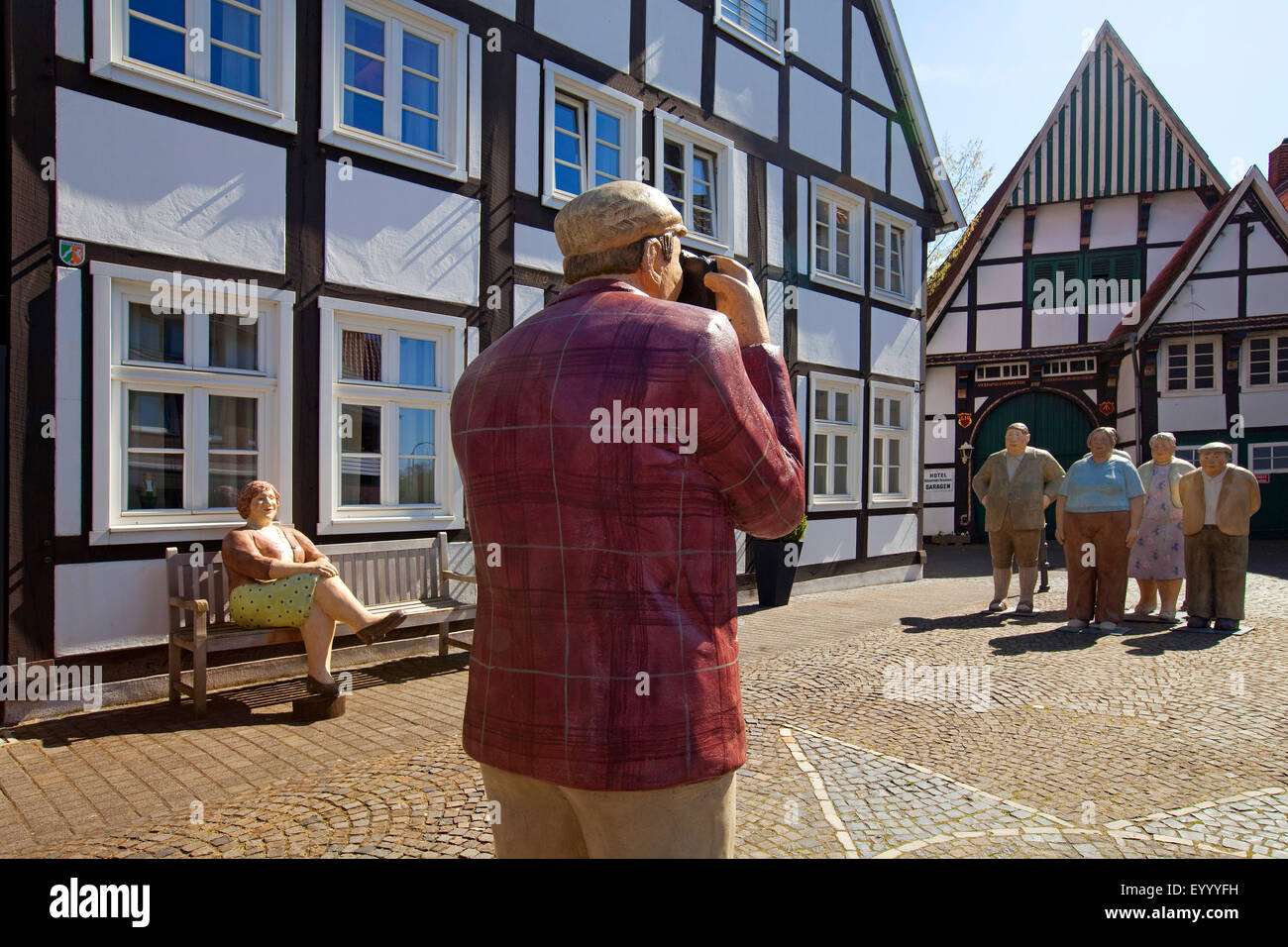 'Alltagsmenschen' in the historic old town of Wiedenbrueck, Germany, North Rhine-Westphalia, East Westphalia, - Stock Image