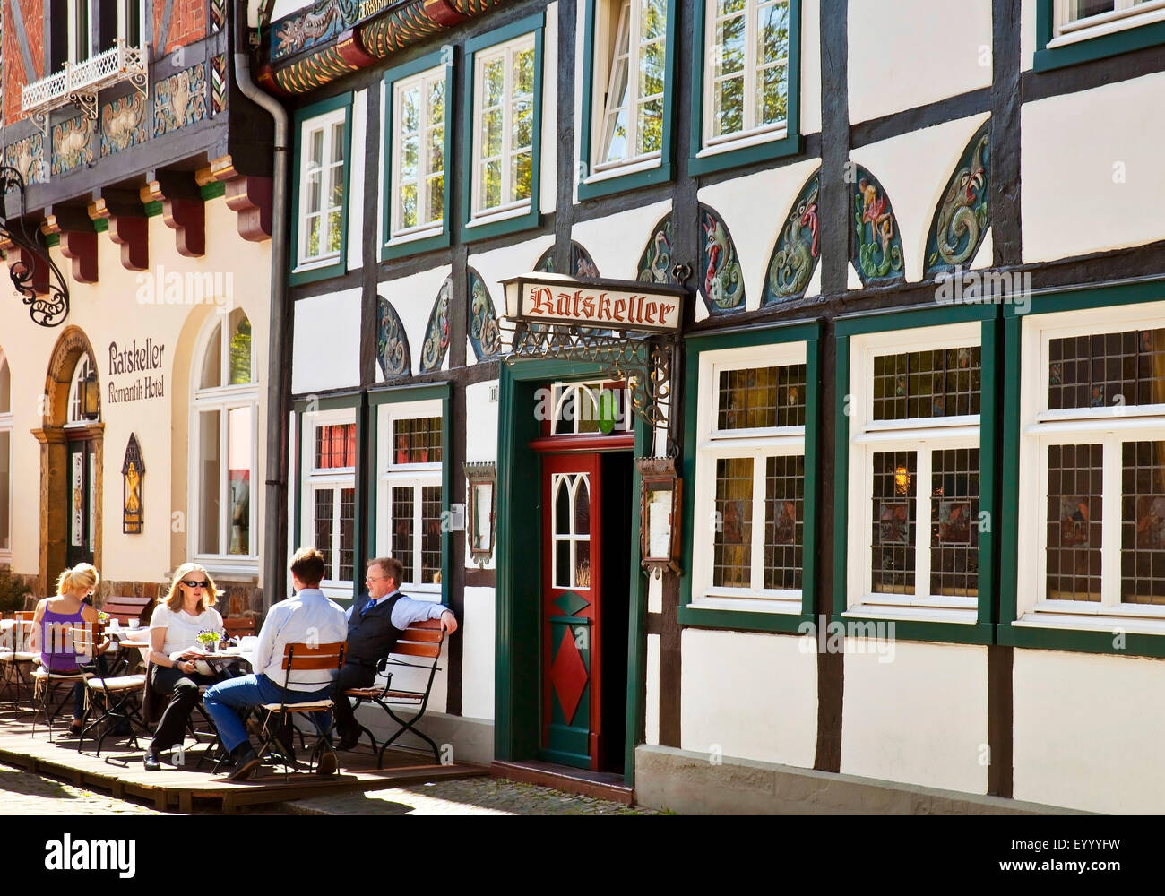 people in a sidewald cafe in the historic old town of Wiedenbrueck, Germany, North Rhine-Westphalia, East Westphalia, - Stock Image