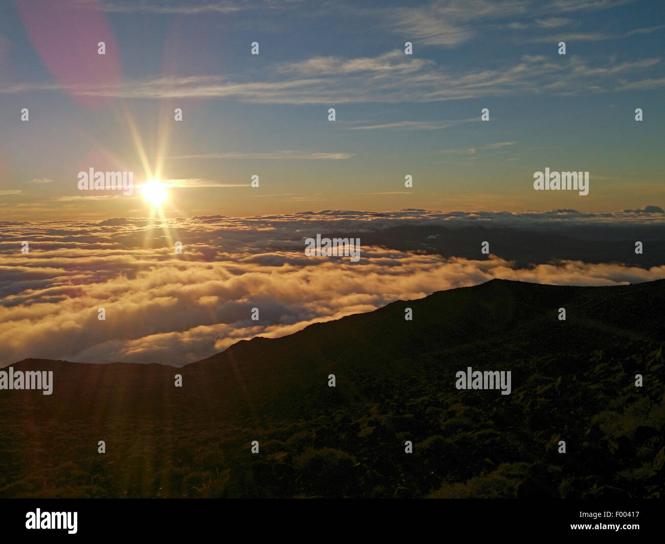 view from mountain summit of volcano  Piton des Neiges at sunrise, Reunion - Stock Image