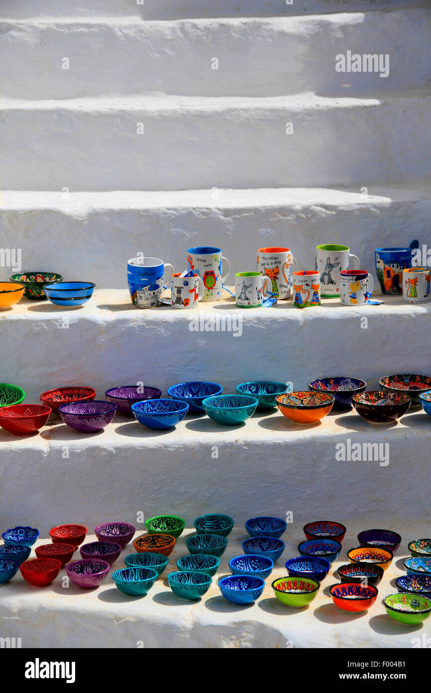 coloured ceramic dishes and cups on a white stone stair, souvenirs, Greece, Cyclades, Santorin, Thira - Stock Image